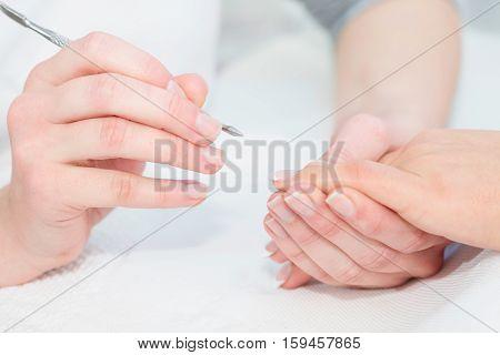Manicure work, toned image, white, horizontal image