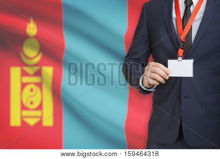 Businessman Holding Name Card Badge On A Lanyard With A National Flag On Background - Mongolia
