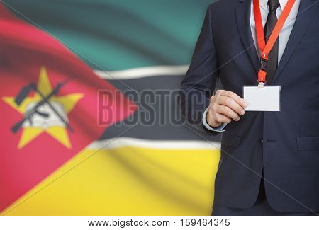 Businessman Holding Name Card Badge On A Lanyard With A National Flag On Background - Mozambique