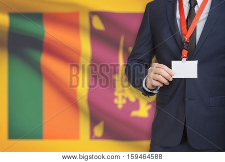 Businessman Holding Name Card Badge On A Lanyard With A National Flag On Background - Sri Lanka