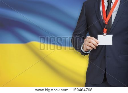 Businessman Holding Name Card Badge On A Lanyard With A National Flag On Background - Ukraine