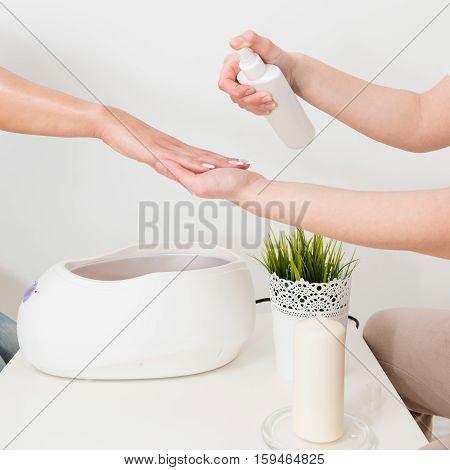 Preparing For Paraffin Wax Bath Beauty Treatment
