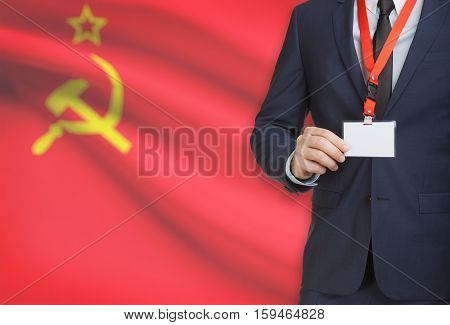 Businessman Holding Name Card Badge On A Lanyard With A National Flag On Background - Soviet Union -