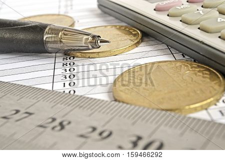 Financial background with money ruler calculator graph and pen.