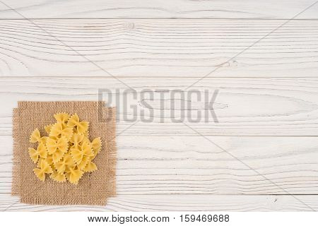 Pasta in an old white wooden table. Abstract background empty template. Top view.
