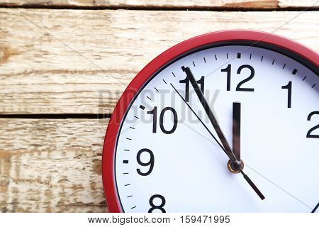 Red Round Clock On A Grey Wooden Table