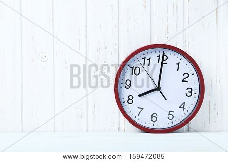 Red Round Clock On A Wall Paneling Background