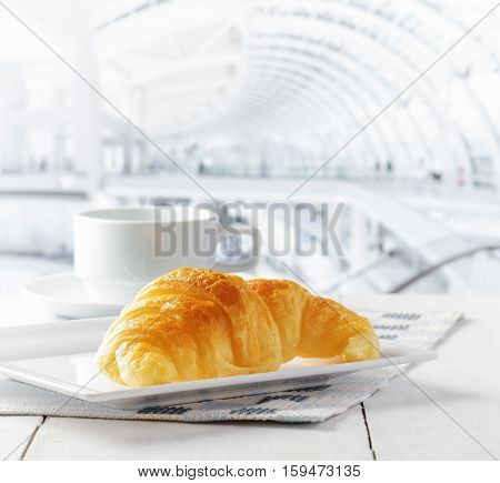 Cup Of Coffee And Croissant In Cafe