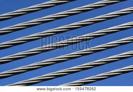 Closeup of a strong steel cable and clear sky in the background