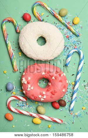 Glazed Donuts On Green Background
