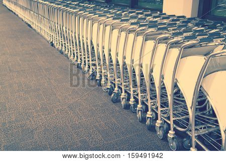 luggage carts at airport terminal ( Filtered image processed vintage effect. )