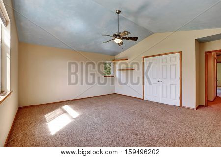 Creamy Tones Empty Room With Closet And Shelves