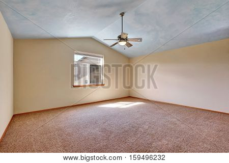 Creamy Tones Empty Room With Vaulted Ceiling