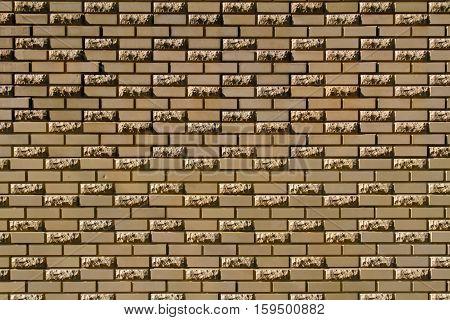 Brick wall made of light yellow facing bricks