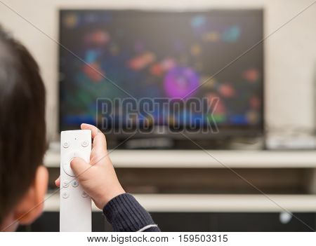 kid playing a TV game with remote control