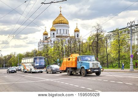 MOSCOW RUSSIA - May 02.2016: Prechistenskaya embankment. Road along the river Moskva next to Cathedral of Christ the Saviour