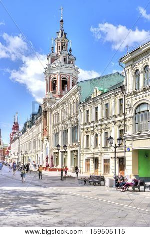 MOSCOW RUSSIA - July 08.2015: Nikolskaya Street. Facades of ancient mansions and bell tower of the Monastery of St. Nicholas
