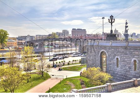 MOSCOW RUSSIA - May 02.2016: Cathedral of Christ the Saviour and Patriarshy pedestrian Bridge across the river Moskva