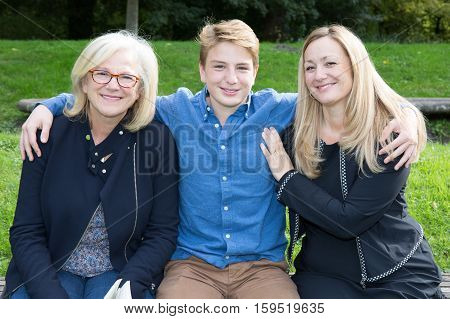 three generations with mother teenager and grandmother