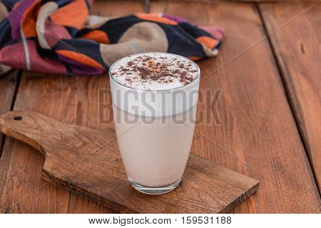 One glass coffee shot close-up in the decoration on the wooden table