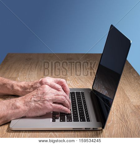 Senior Adult Man Touch Types On Laptop