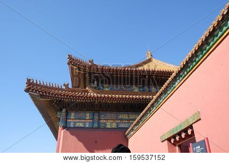 BEIJING - FEBRUARY 23:  Tiled roof and facade decorated with a Chinese pattern. Palace in The Forbidden City, Beijing, China, February 23, 2016.
