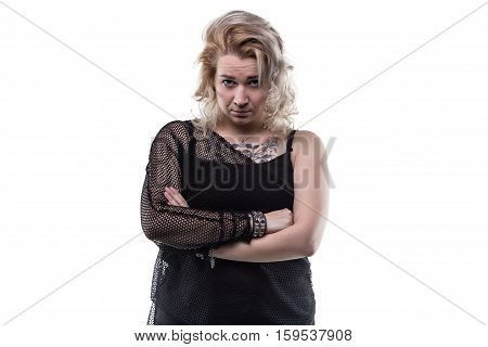 Frowned blond woman with arms crossed on white background