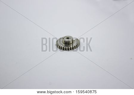nickel, shiny, gear on a white background