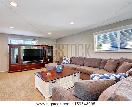 Cozy Family Room With Brown Sectional Sofa