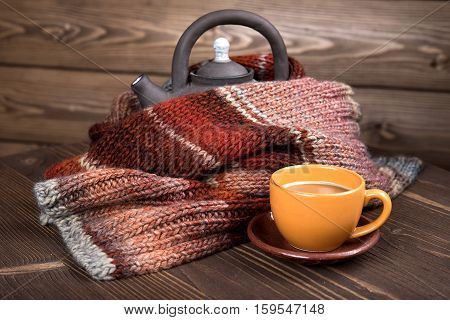 Kettle And A Coffee Cup In A Wooden House, Winter Knitted Scarf