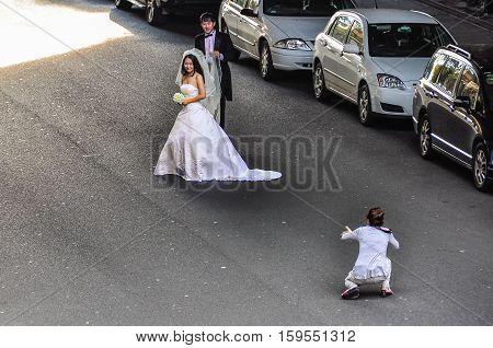 SYDNEY AUSTRALIA - AUGUST 29 2012: Wedding photo shoot on a road in Sydney Australia