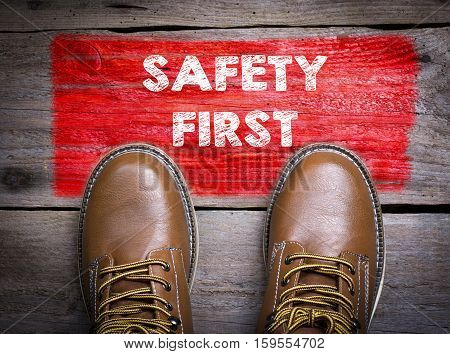 Safety First. Top View of Boot on wooden background