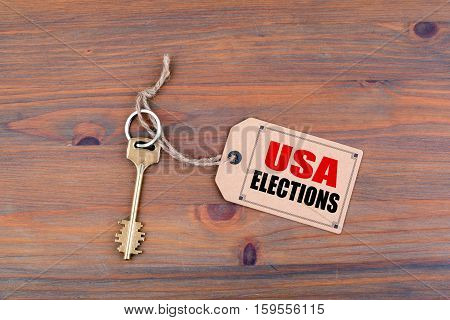 Key and a note with text: USA Elections.