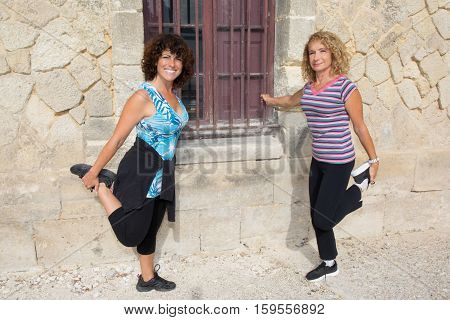 two mature woman making senior sport or fitness