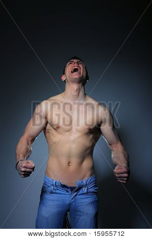 Muscular man screaming studio shot