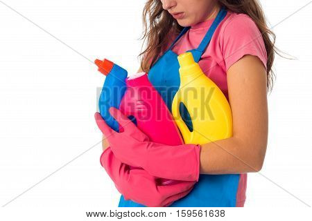 closed up of young maid woman in an apron with cleansers isolated on white background