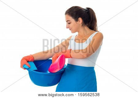 portrait of young maid woman in uniform with cleansers isolated on white background