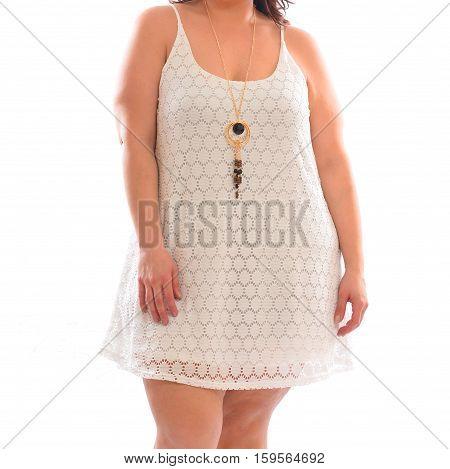 Plus size fashion model woman wearing stylish white summer dress isolated on white background.