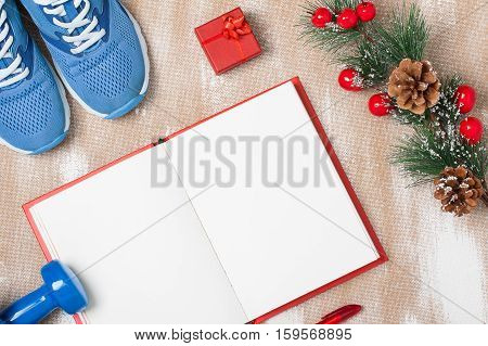 Christmas Sport Composition With  Shoes, Dumbbells And Note