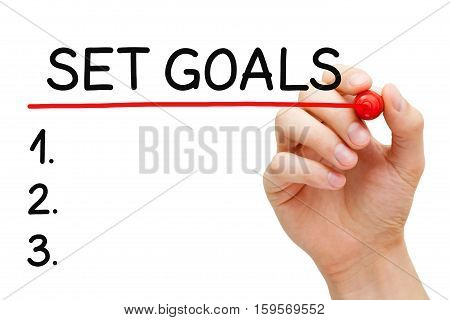 Hand writing Goals setting list with marker on transparent wipe board.