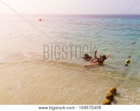 Tourists enjoy swimming and snorkeling beach area of the island,Thailand