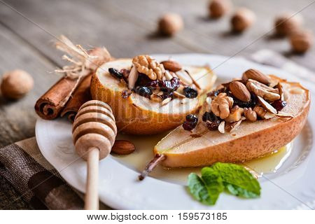 Baked Pears With Honey, Walnuts, Almond Cranberries And Cinnamon