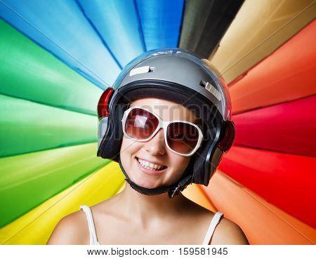 Funny Girl In Helmet Having Fun. Multicolored Background