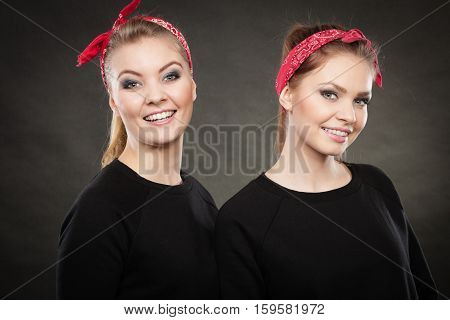 Love and affection in family. Blonde gorgeous sisters stylized on retro pin up vintage style. Two girls in red handkerchief smiling feel enjoyable happy.