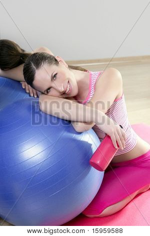 aerobics woman blue pilates ball relax water bottle smiling in sport gym mirror