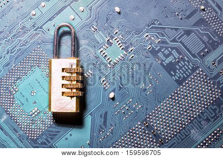 Combination Padlock On Motherboard Computer For Security Concept
