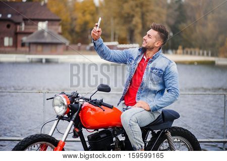 Fashionable Guy On The Bike Makes A Selfie