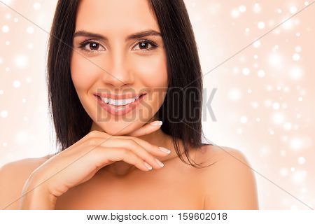 Pretty Young Woman Touching Chin On Christmas Background
