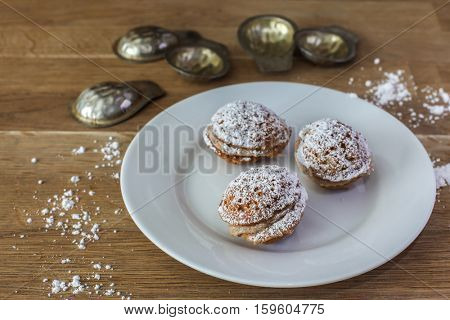 Three sweet slovakian cookies on white plate with forms