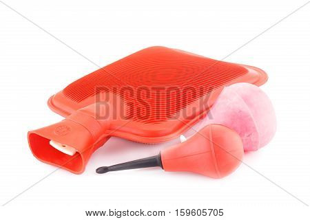 Red rubber hotty and enemas isolated on white background.